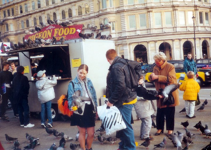 Feeding pigeons on Trafalgar Square, London in 2001