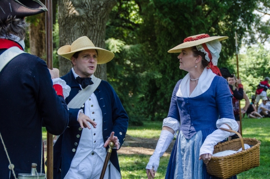 Locals in period costume and the First Virginia Regiment prepare for a military drill during Mount Vernon's 4th of July Celebration