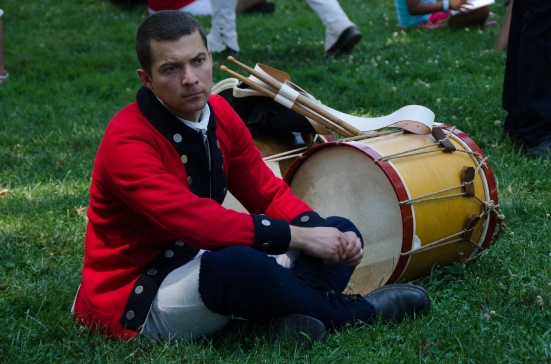 Drummer of the First VA Regiment, wearing a coat of opposite colors than the soldiers, waiting for a military drill at Mount Vernon
