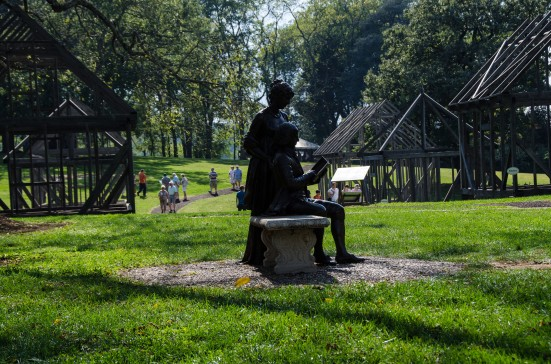 James and Dolley Madison at Montpelier against reconstructions of slave quarters