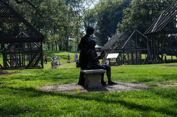 Slave Quarters at James Madison's Montpelier, against the serene sculpture of James and Dolley Madison