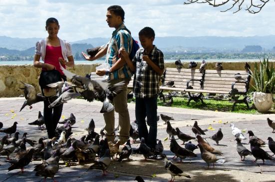 Feeding pigeons at Parque de las Palomas, San Juan, Puerto Rico