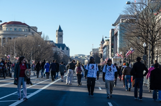 People wandering along Pennsylvania Avenue, prepared for the 2013 inauguration