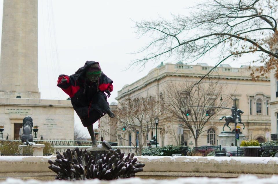 Wintry statues in Baltimore's Mount Vernon Square