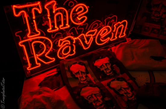 The Raven beer sign and t-shirts