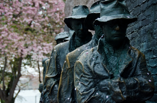 Statues at the Franklin Delano Roosevelt memorial, cherry blossoms, Washington DC