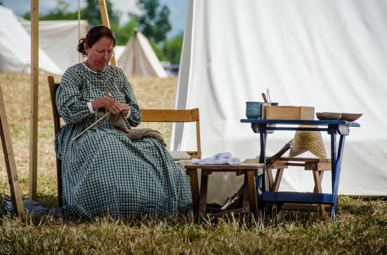 Female reenactor knitting, Reenactor encampment, 150th Anniversary Gettysburg Battle Reenactment