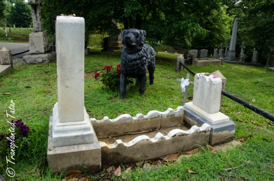 Iron dog statue by a grave at Hollywood Cemetery, Richmond, Virginia