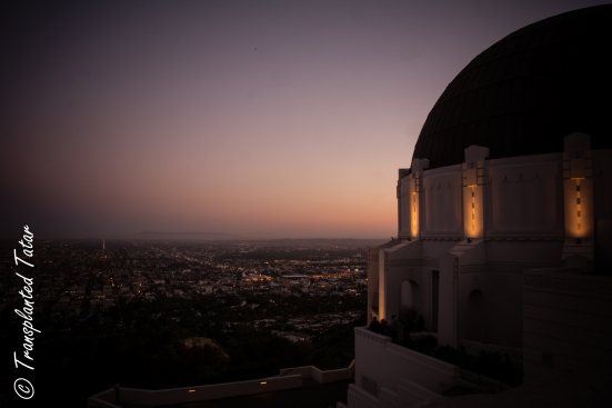 The sun sets over Los Angeles and the Griffith Observatory
