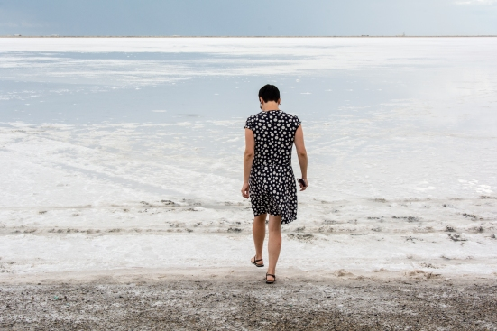 Woman walking over Bonneville Salt Flats, Utah