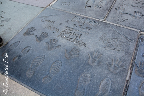 Daniel Radcliffe, Rupert Grint, and Emma Watson prints in Forecourt of Stars, Grauman's Chinese Theatre, LA